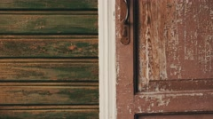 Mother open door walk from country house on street with son. Countryside Stock Footage