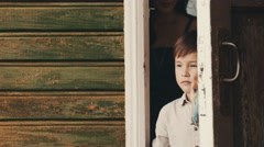 Mother open door walk out from country house with son. Countryside. Smile Stock Footage