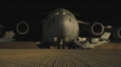 Airmen prepare secure and transport a USMC M1A1 Abrams tank to Afghanistan Stock Footage