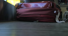 Suitcase on luggage conveyor belt at airport Stock Footage