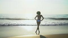 Happy ethnic woman having fun on vacation beach Stock Footage