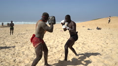 Traditional African sport - Senegalese wrestling on the beach Stock Footage
