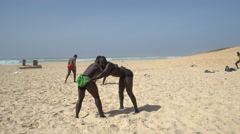 Senegalese wrestling on the beach - Traditional African sport Stock Footage