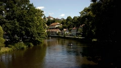 Vltava River In Cesky Kumlov With Row Boat Stock Footage