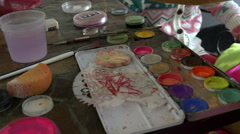 Gouache paint brush sponge water and the other when working with akvagrimom Stock Footage