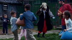 Happy children fight pillows in yard of country house. Summer. Entertainment Stock Footage