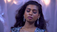 Portrait of young Indian American woman fashion model wearing blue glitter gown Stock Footage