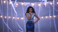 Portrait of attractive Indian Asian girl modelling glitter gown for fashion show Stock Footage