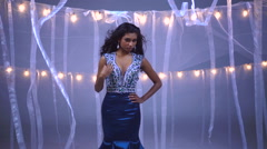 Portrait of young ethnic woman modelling glitter dress for fashion show Stock Footage