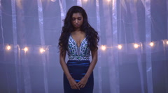Portrait of attractive Indian American woman model being filmed in glitter dress Stock Footage