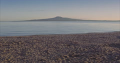 Aerial of calm water on beach near Rangitoto island, auckland Stock Footage