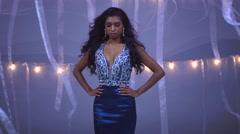 Portrait of Indian American girl model being filmed in elegance gown in studio Stock Footage