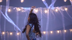 Portrait of attractive Indian Asian woman model being filmed in glitter dress Stock Footage