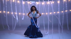Portrait of slim Indian American girl model being filmed in beautiful gown Stock Footage
