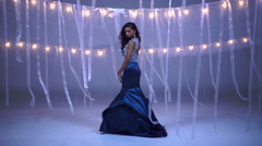Attractive slim Indian American girl fashion model wearing luxury gown Stock Footage