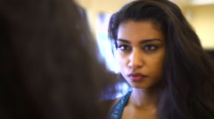 Young Indian Asian woman concentrating in front of mirror in fitness studio Stock Footage