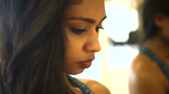 Slim Indian American female concentrating in front of mirror in fitness studio Stock Footage