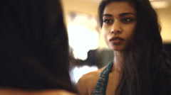 Young Indian Asian woman concentrating in front of the mirror in fitness studio Stock Footage