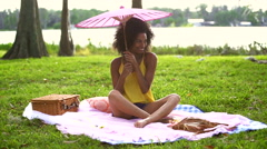 Happy African American teenager feeling free in park outdoors Stock Footage