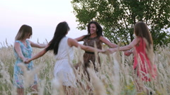 Beautiful girl dancing in a field - spikes in the sunset Stock Footage