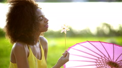 Young African American female listening music on Summer holiday outdoors Stock Footage