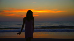 Silhouette of beautiful Caucasian American woman on leisure vacation beach Stock Footage