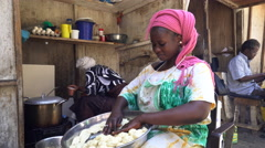 African woman knead dough in the market - Dakar, Senegal Stock Footage