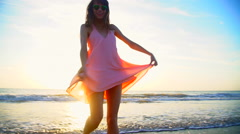 Attractive Caucasian American woman posing on beach on vacation at sunset Stock Footage