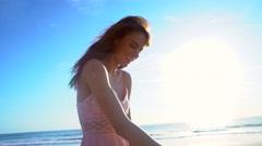 Portrait of cute Caucasian American woman enjoying holiday beach at sunshine Stock Footage