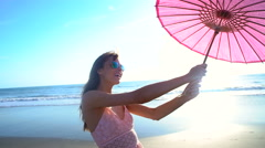 Portrait of attractive Caucasian American woman posing on beach on holiday Stock Footage
