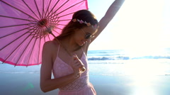 Portrait of hippie Caucasian American girl on leisure vacation beach Stock Footage