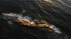 Aerial of rocky coast at Cape Breton Island with sunset Stock Footage