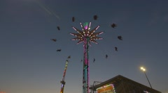 Toronto CNE The Ex Sunset Large Sky Swing Tower Silhouette Slow Motion Wide Low Stock Footage