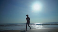 Silhouette of happy African American woman enjoying holiday beach Stock Footage