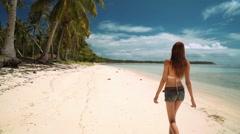 Girl walking on white sand beach on tropical island Stock Footage