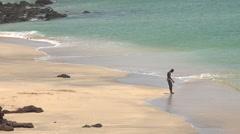 One black man an African beach - beach of Dakar, Senegal Stock Footage