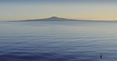 Aerial of calm water and Rangitoto island, auckland Stock Footage
