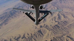 An A-10 Thunderbolt gets refueled by a KC 135 Stratotanker. Stock Footage