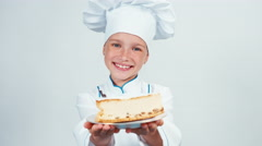 Close up portrait baker holds piece of cheesecake sniffing it and gives you it Stock Footage