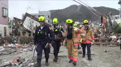 Search and rescue teams hunt for survivors following the devastating earthquake Stock Footage