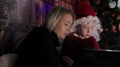 Mother and son playing on a laptop at christmas Stock Footage