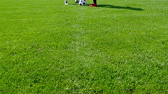 Two players at the center point of a football field ready to start the match Stock Footage