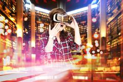 Double exposure, young girl getting experience VR headset, is using augmented Stock Photos