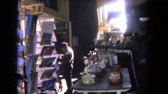 1962: a brief look at a tourist stop to buy postcards and other unique items  Stock Footage
