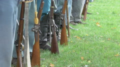 Civil War soldiers feet and guns in a row Stock Footage