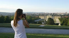 Woman takes picture of palace and garden in Vienna Stock Footage