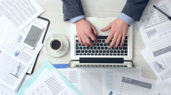 Businessman working at office desk Stock Footage