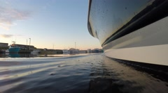 Low shot of a large boat during sunset on a calm ocean Stock Footage