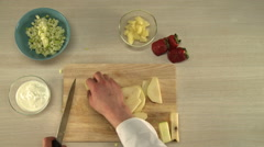 Cooking of fruit salad. First-person view Stock Footage