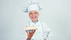 Baker holds piece of cheesecake and gives you it. Chef 7-8 years smiling Stock Footage